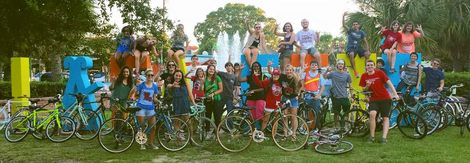 Cyclists pose for picture in downtown Lafayette, Louisiana.